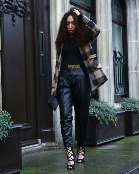 from hats to heels blogger belt curly hair leather pants strappy sandals black pants moschino flannel coat pants top shoes bag