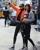 blouse,gigi hadid,bella hadid,workout leggings,tommy hilfiger crop top,grunge,starbucks coffee,jacket,hadid sisters,gigi hadid style,streetstyle,sunglasses,gigi and bella hadid