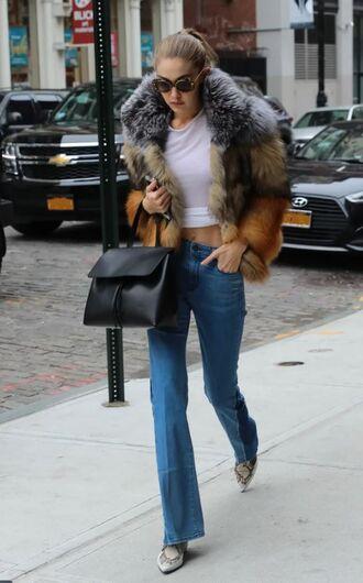 jacket fur jacket streetstyle crop tops jeans flare jeans gigi hadid model off-duty