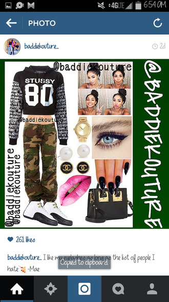 stussy urban baddiekouture_ outfit idea bag outfit ootd number cropped sweater cropped hoodie camouflage chanel hair bun eye makeup black nails pink lipstick air jordan gold watch instagram