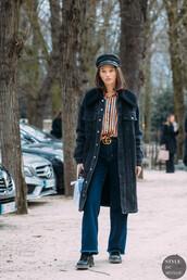 hat,black hat,baker boy hat,denim coat,jeans,high waisted,shirt,striped top,sailor hat,boots,black boots,belt