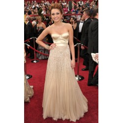 Miley cyrus champagne formal dress at the 82nd annual oscar awards red carpet