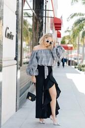 pants,black pants,high waisted pants,top,bag,white sunglasses