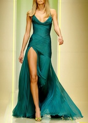 dress,green dress,green formal gown,evening dress,prom dress,emerald prom dress,crowl neck line,green,flow dress,leg split,cleavage,emerald dress,fashion,sexy gown,sexy evening gown,sexy prom dress,pleated green dress,formal wear,evening wear,sexy dress,crowl,asap,sel,leg slit,theigh,long legs