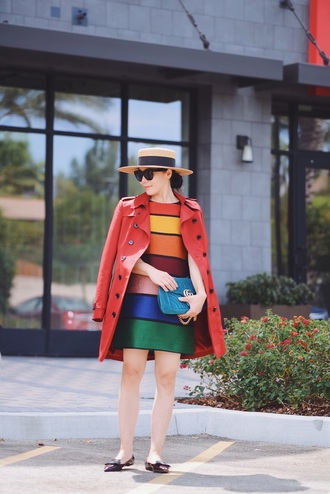 hallie daily blogger bag coat sunglasses hat red coat striped dress rainbow mini dress blue bag flats black flats