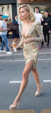 dress,gold,gold dress,sandals,hailey baldwin,model,cannes,mini dress,plunge v neck,sequins,sequin dress