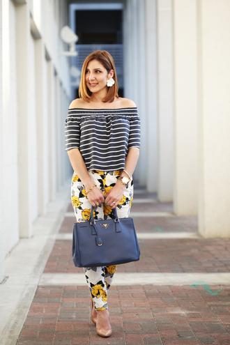 top off the shoulder top white floral pants black bag nude heels blogger stripes