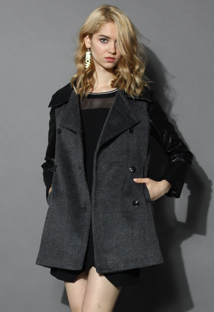 Breasted black coat with twill sleeves