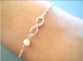 jewels,bracelets,infinity,infinite bracelets,silver,infinite,pearl,pretty,jewelry,infinity bracelet,silver bracelet