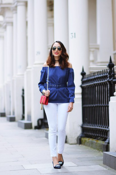 preppy fashionist blogger shoes sunglasses blouse jeans bag off the shoulder blue top red bag yves saint laurent mini bag white pants black flats striped off shoulder top blue off shoulder top belted top ysl ysl bag shoulder bag off the shoulder top aviator sunglasses black choker choker necklace necklace jewels white jeans embellished pointed flats flats spring outfits