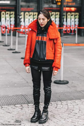 jacket fashion week 2017 tumblr red jacket sports jacket hoodie black hoodie shorts black shorts leather shorts tights opaque tights boots black boots over the knee boots wedges streetstyle
