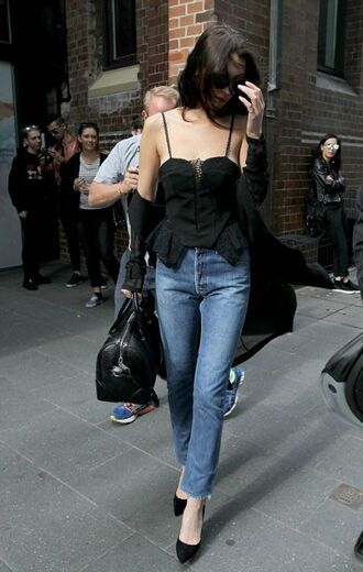 top bella hadid celebrity model black top summer outfits coat black coat jeans blue jeans pumps black pumps bag black bag handbag sunglasses black sunglasses