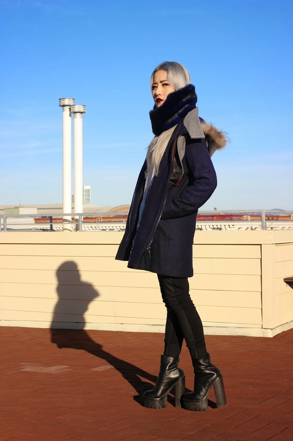 feral creature coat scarf sweater jeans shoes