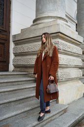 coat,brown coat,black shoes,tumblr,long coat,pants,blue pants,shoes,bag,handbag,fall outfits