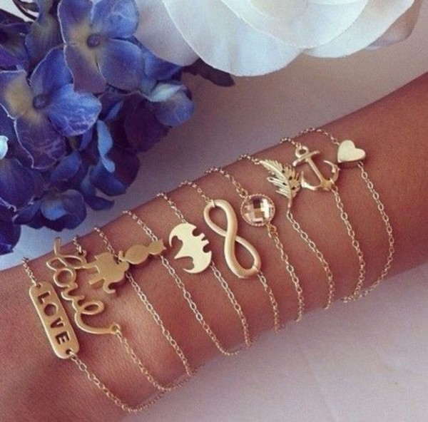 jewels gold bracelets batman cats infinity love more feathers diamonds
