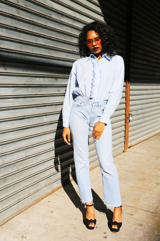 man repeller blogger sunglasses make-up mom jeans blouse button up blue top black heels