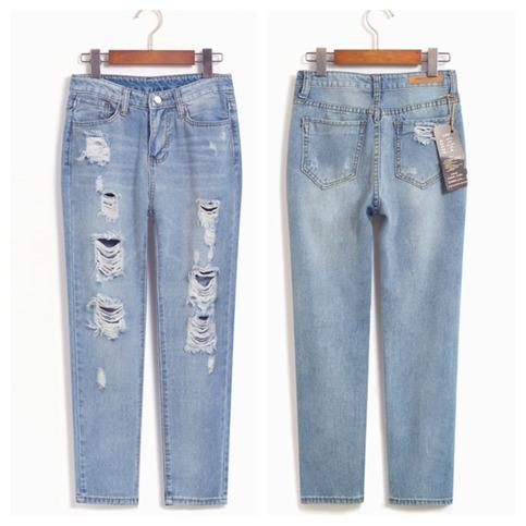 Light blue cutout boyfriend jeans