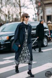 coat,trench coat,black coat,dress,shoes,heels,socks,bag,blue bag,sunglasses