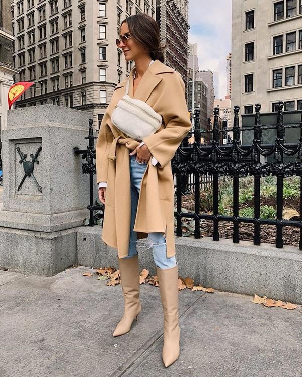 coat camel coat heel boots jeans white bag crossbody bag sunglasses