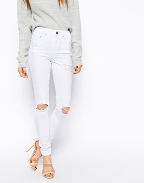 ASOS Ridley High Waist Ultra Skinny Jeans in White with Thigh Rip And Busted Knees at asos.com