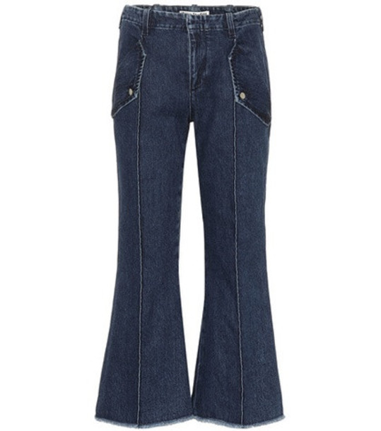 Acne Studios Frayed hem high-rise flared jeans in blue