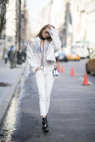 jeans nyfw 2017 white lace fashion week 2017 fashion week streetstyle white jeans boots black boots ankle boots lace top white lace top shirt white shirt jacket white jacket white fur jacket fur jacket choker necklace black choker all white everything mini bag