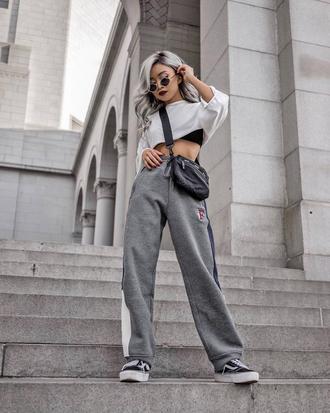 pants tumblr grey pants wide-leg pants top crop tops cropped hoodie athleisure sneakers black sneakers bag crossbody bag sunglasses
