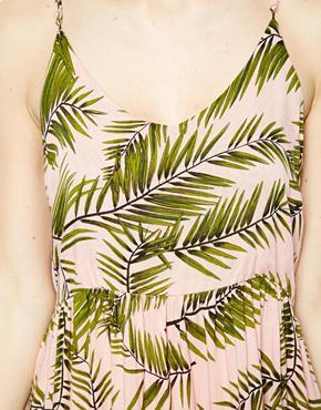 Ganni | Ganni – Trägerkleid mit Palmblattaufdruck bei ASOS