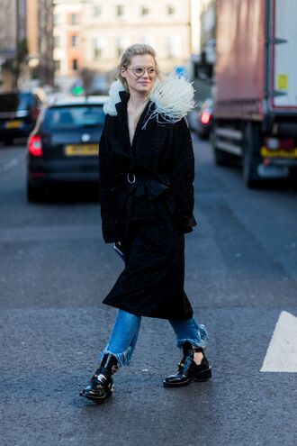 coat london fashion week 2017 fashion week 2017 fashion week streetstyle black coat fur collar coat denim jeans blue jeans cropped jeans frayed denim frayed jeans boots black boots ankle boots cut-out ankle boots cut out ankle boots flat boots sunglasses