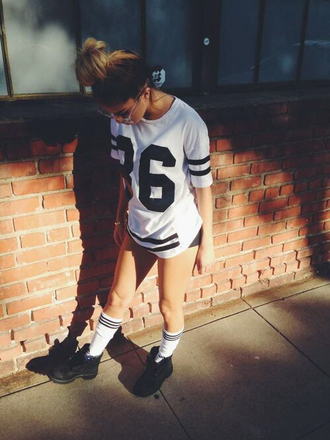 shirt big shirt varsity tee white black timberlands number 86 socks bun blonde hair brunette glasses shoes