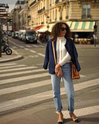 blouse white blouse jacket blue jacket jeans blue jeans shoes beige shoes bag brown bag