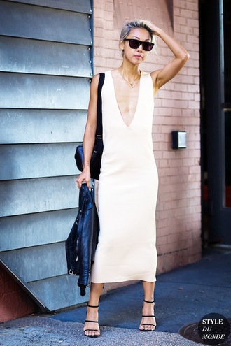 le fashion image blogger shoes white dress v neck dress leather jacket maxi dress sandals sandal heels dress nude slip dress slip dress nude dress club dress plunge v neck jacket black jacket sunglasses black sunglasses the haute pursuit high heel sandals black high heels black sandals