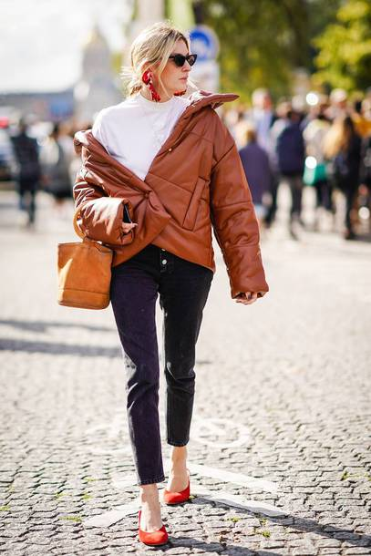 jacket puffer jacket brown jacket red shoes shoes white top brown bag bag black pants pants red earrings sunglasses