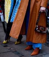 shoes,leather coat,tumblr,boots,brown boots,pointed boots,high heels boots,denim,jeans,blue jeans,coat,camel,camel coat,camel long coat,long coat,bag,buckle bag,printed bag,fashion week 2017,streetstyle