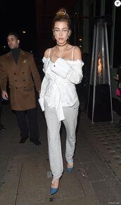 pants,shirt,white shirt,hailey baldwin,streetstyle,model off-duty,london fashion week 2017,fashion week 2017,sweatpants,blouse,glasses,sunglasses