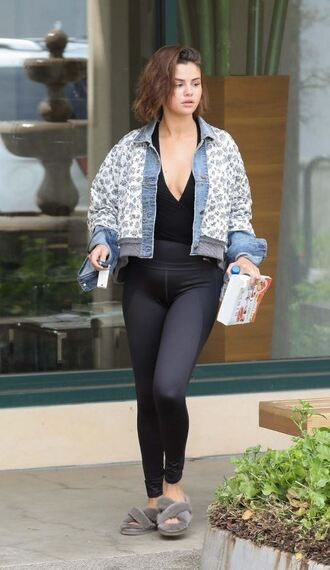 top plunge v neck selena gomez streetstyle leggings jacket denim jacket spring outfits slide shoes wrap top black top shoes