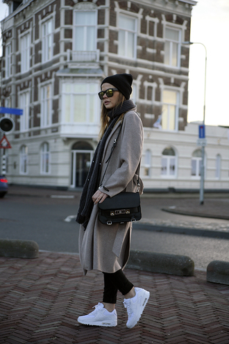 fashion zen blog blogger sunglasses winter coat scarf white sneakers winter outfits coat jeans top shoes bag hat
