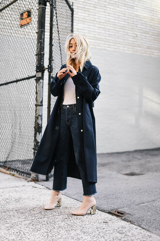 coat black trench coat white shirt flared jeans nude heels blogger