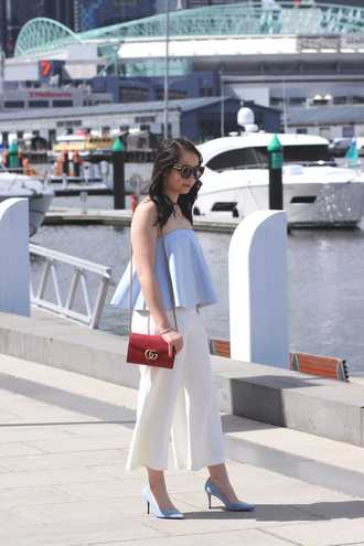 an odd girl blogger sunglasses top pants shoes bag jewels fall outfits blue top summer outfits red bag gucci bag shoulder bag pumps high heel pumps blue heels white pants