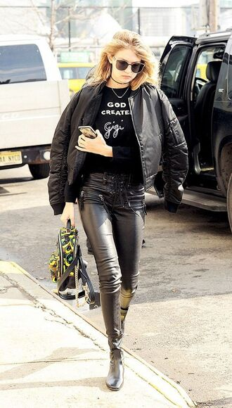 sweater bella freud gigi hadid celebrity celebrity style model black sweater pants leather pants black pants jacket black bomber jacket bomber jacket black jacket bag black bag sunglasses black sunglasses fall outfits