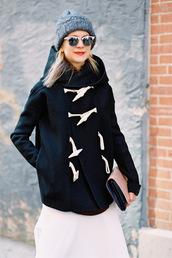 vanessa jackman,blogger,knitted beanie,mirrored sunglasses,clutch,duffle coat,sweater,skirt,coat