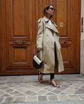 bag,handbag,mid heel sandals,coat,black sunglasses,sweater,black pants