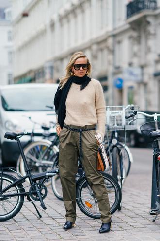 sweater scarf copenhagen fashion week streetstyle nude sweater pants khaki khaki pants boots black boots knitted scarf sunglasses