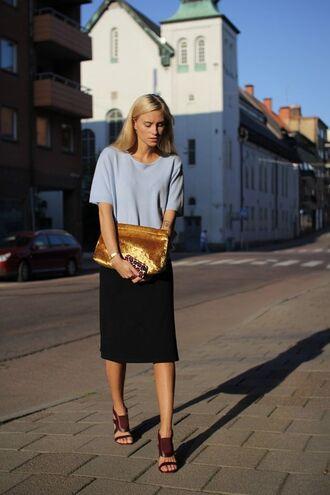 gold clutch bag clutch metallic clutch skirt black skirt gold bag top grey top high heel sandals sandals brown sandals spring outfits