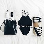 swimwear,black,white,water bottle,bikini,earphones,bag,blanket,watch,home accessory