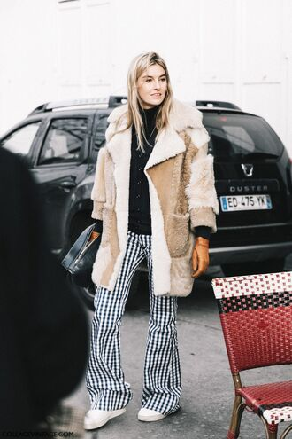coat tumblr camel camel coat fur coat camel fur coat pants printed pants flare pants sweater black sweater streetstyle fashion week 2017 checkered sneakers white sneakers cardigan black cardigan top black top turtleneck black turtleneck top leather gloves gloves