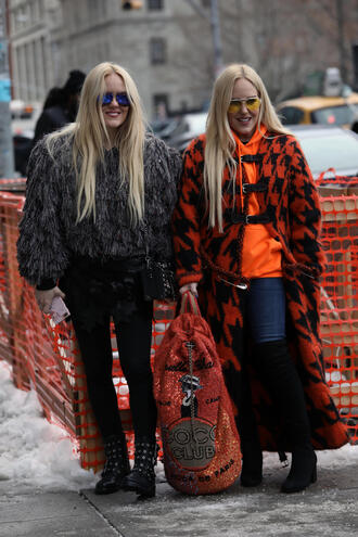 coat nyfw 2017 fashion week 2017 fashion week streetstyle orange orange coat houndstooth hoodie denim jeans blue jeans boots black boots over the knee boots backpack tights opaque tights mini skirt stars jacket grey jacket grey fur jacket fur jacket sunglasses yellow sunglasses