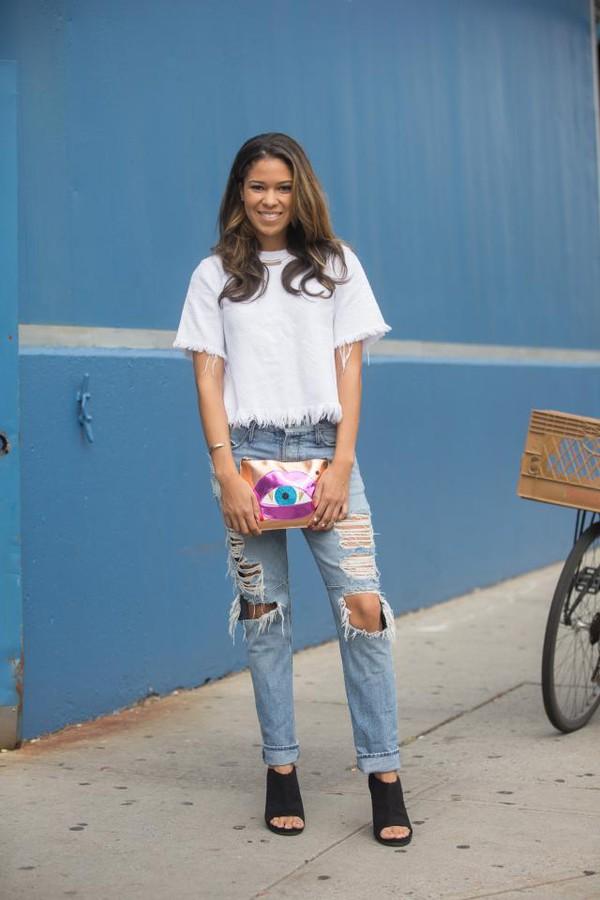 jeans white t-shirt distressed denim jeans black boots colorful purse blogger