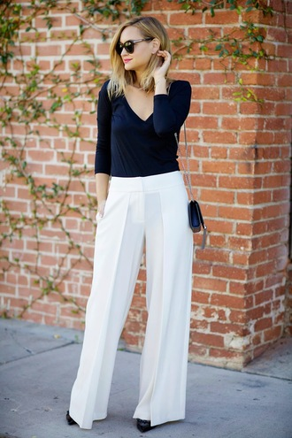 late afternoon blogger sunglasses flare pants wide-leg pants mini bag white pants v neck pants top shoes bag jewels
