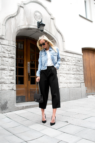 victoria tornegren blogger denim jacket culottes chanel bag pointed toe pants black culottes black pants high waisted pants black top white top jacket blue jacket pointed toe pumps pumps black pumps bag black bag sunglasses black sunglasses streetstyle fall outfits